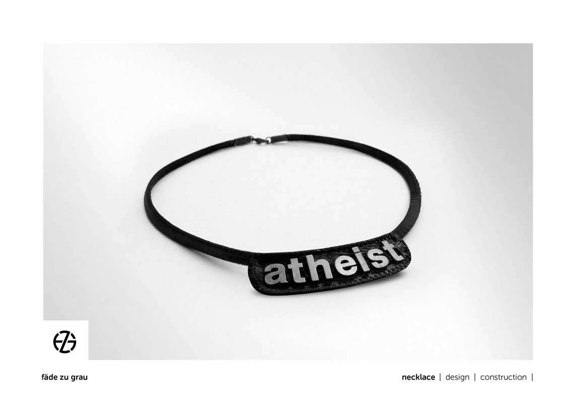 """black leather band necklace with metal letters spelling """"atheist"""""""