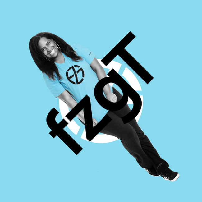 female model presents blue t-shirt with black logo, front view