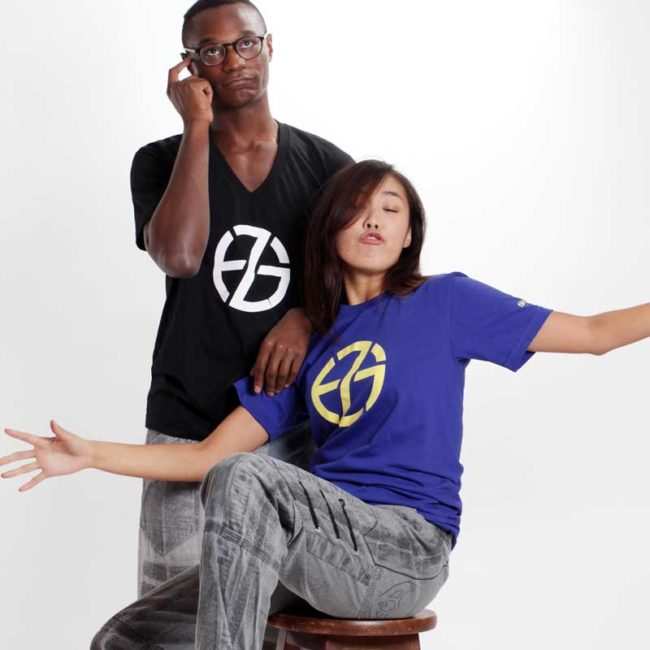 male and female model present black and blue t-shirts with fade zu grau logo symbol printed on front