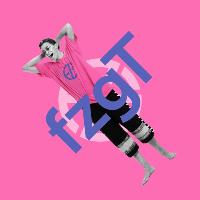 female model presents pink t-shirt with blue logo print